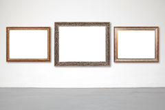 Classic frame on white cement wall in gallery. Royalty Free Stock Images