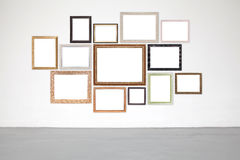 Classic frame on white cement wall in gallery. Stock Photos