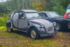Classic French car Citroen 2 CV in grey. Old cars and motorbikes meeting and show in Gdansk Oliwa, Poland, October 7th, 2018. Autumn light, front view royalty free stock photography