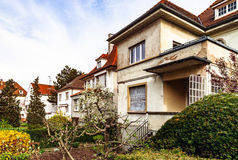 Classic french house in residential district of Strasbourg, blos. Som spring time, flowering and gardening. France Royalty Free Stock Photo