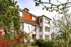 Classic french house in residential district of Strasbourg, blossom spring time, flowering and gardening. France stock images