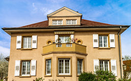 Classic french house in residential district of Strasbourg, blos. Som spring time, flowering and gardening. France Stock Photos