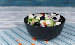Classic fresh beautiful delicious Greek salad. With olives and feta cheese in a black plate Royalty Free Stock Image