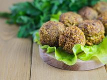 Classic freshly made falafel on a salad leaf on a cutting Board. stock image