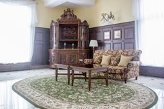 Classic furniture - table and chairs in hall. Classic furniture - table and chairs in hall Stock Images