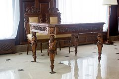 Classic furniture - table and chairs in hall. Classic furniture - table and chairs in hall Stock Photography