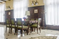 Classic furniture - table and chairs in hall. Classic furniture - table and chairs in hall Royalty Free Stock Image