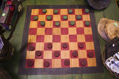 A Classic Game of Checkers. A Rustic Green and Red Game of Checkers stock photography