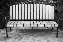 Classic garden bench. In black and white royalty free stock photos