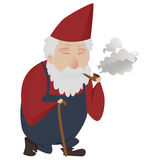 Classic garden gnome. With walking stick smoking a pipe Royalty Free Stock Photography