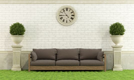 Classic garden with sofa Royalty Free Stock Photography