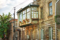 Classic Georgian style Old wooden balcony on the street of Tbilisi old town royalty free stock image