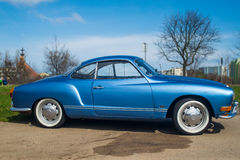Classic German car Volkswagen Karmann Ghia. Classic German oldtimer, beautiful blue Volkswagen Karman Ghia, parked in Gdansk, Poland Royalty Free Stock Images