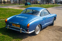 Classic German car Volkswagen Karmann Ghia. Classic German oldtimer, beautiful blue Volkswagen Karman Ghia, parked in Gdansk, Poland. Yellow number plates for a Royalty Free Stock Photo