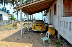 Classic German Volkswagen Beetle yellow car parked under shelter in Pattani Thailand. Pattani, Thailand - May 9, 2017: A classic Volkswagen Beetle yellow vehicle royalty free stock images