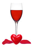Classic Glass of Red Wine, heart and rose petals isolated on a w Stock Photography