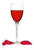 Classic Glass of Red Wine and rose petals isolated on a white Royalty Free Stock Image
