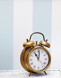 Classic gold clock  watch in bright colorful interior Royalty Free Stock Image