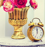 Classic gold clock  watch in bright colorful retro interior Royalty Free Stock Photos