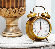 Classic gold clock  watch in bright colorful retro interior Royalty Free Stock Image