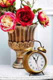 Classic gold clock  watch in bright colorful retro interior Royalty Free Stock Photo