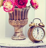 Classic gold clock  watch in bright colorful retro interior Stock Photos