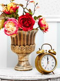 Classic gold clock  watch in bright colorful retro interior Royalty Free Stock Photography