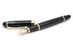 Classic gold fountain pen with cap Stock Photos