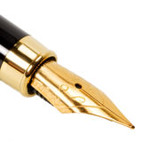 Classic gold fountain pen. Isolated on a white background royalty free stock photos