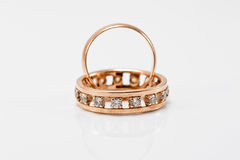 Classic gold wedding band and massive engagement ring Royalty Free Stock Photography