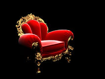 Classic golden chair in the dark Royalty Free Stock Photography