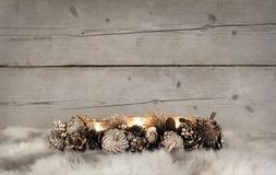 Classic golden Christmas tealight holder with burning candles, on sheepskin Stock Photography