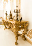 Classic golden table in with old chandeliers Royalty Free Stock Images