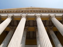 Classic greek columns. Details of classic Greek columns or colonnade on the portico of a large building royalty free stock photography