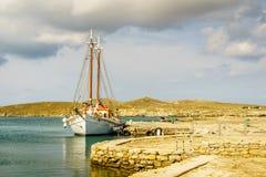 Classic Greek sailboat tied to stone pier Royalty Free Stock Photos