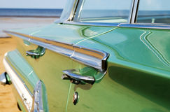 Classic green Cadillac at beach Stock Photography