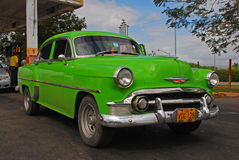 Classic Green Cuban Car in front of a Gas Station in Cuba Stock Photos