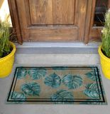 Classic green leaves Outdoor Door mat with twin black borders outside home with yellow flower pots