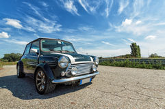 Classic green Mini Cooper. A classic British Green Mini Cooper parked on a sunny day stock image