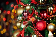 Christmas background with flashing garland on the tree Stock Photos