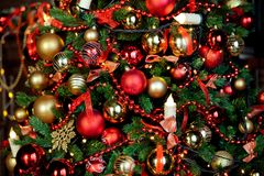 Christmas background with flashing garland on the tree Stock Photography