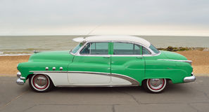 Classic Green and White Buick Super Eight Moto Car parked on seafront promenade. FELIXSTOWE, SUFFOLK, ENGLAND - AUGUST 27, 2016: Classic Green and White Buick Royalty Free Stock Photography