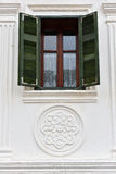Classic green wooden window shutters on a village house Royalty Free Stock Images