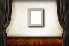 Classic grey Curtain and vintage woody floor as pisplay, one frame photo on the middle of wall, for background Royalty Free Stock Image