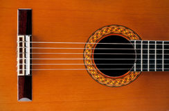 Classic guitar. A wooden classic and acoustic guitar with nylon strings Royalty Free Stock Photo