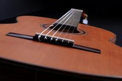 Classic guitar. Close up of a classic guitar made of cedar wood Stock Images