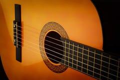 Classic guitar. Detail of classic guitar, closeup Stock Images