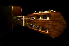 Classic guitar. On the dark background Stock Images