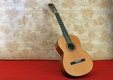 Classic guitar. Classical guitar on retro background Stock Photography