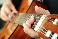 Classic guitar. Man's hands playing classic guitar Stock Images